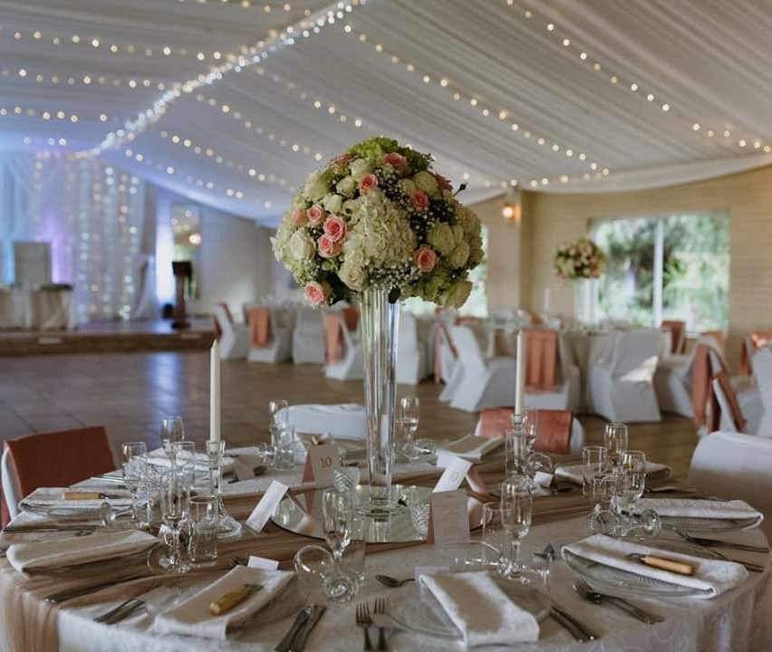 Pink and white wedding table flowers