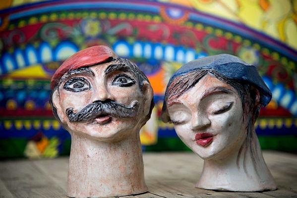 Scultura in ceramica testa di uomo e donna icone siciliane