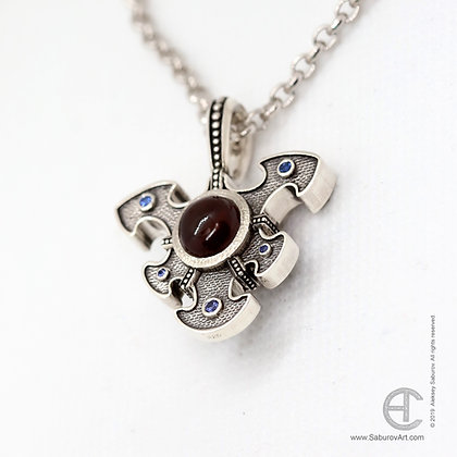 Puzzle pendant with garnets and sapphires. Style #PP003SGS