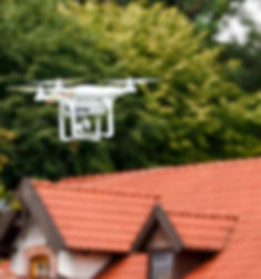 drone-flying-in-front-of-a-home.jpg