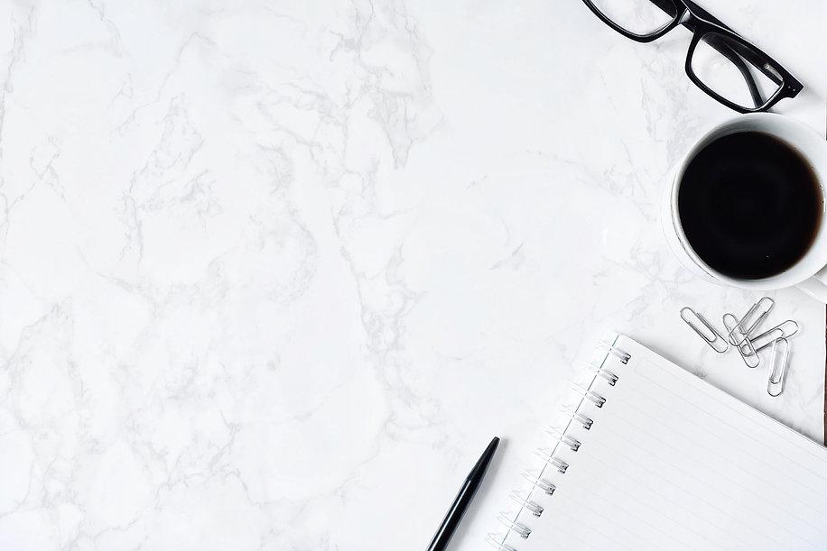 Business desk composition. Notebook, pen