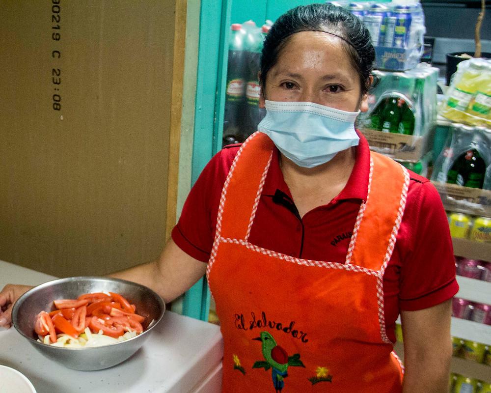 Maria, a cook at Paraiso Tropical Latin Food Market.