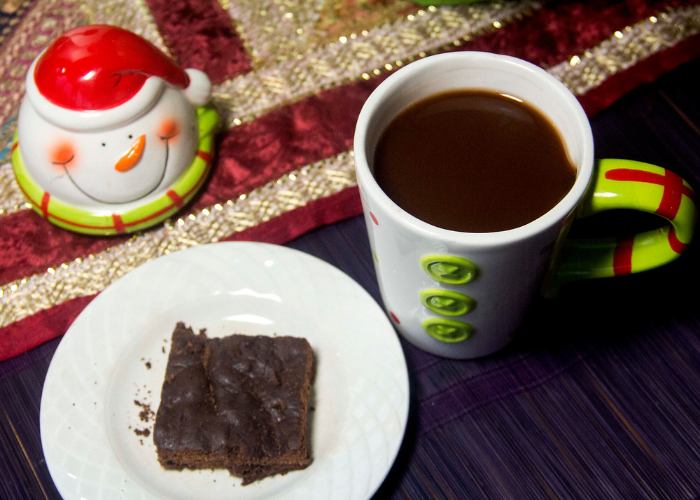 Pair a brownie with spiced hot cocoa made with cinnamon, star anise, all-spice & cayenne pepper.