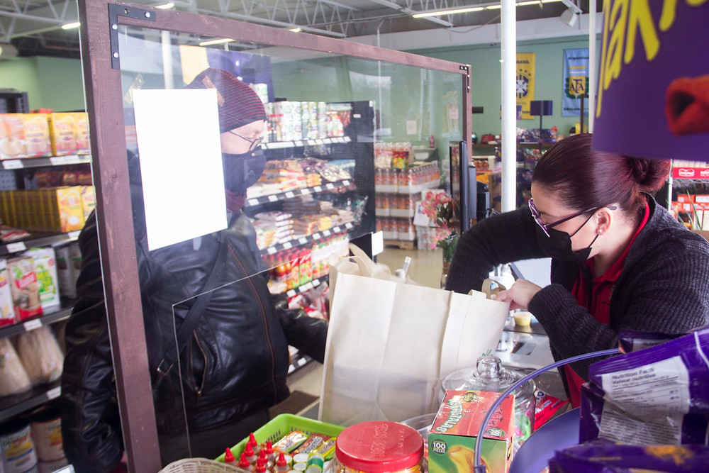 Paraiso South manager Natalia Marcenaro assists a customer.