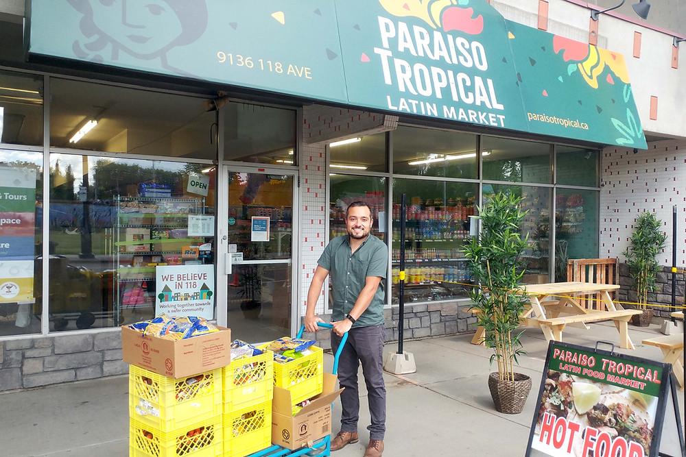 Jesus Gonzalez Rivas Jr. brings out food donations from Paraiso North.