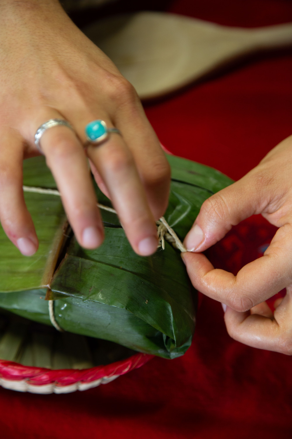 Wrapping a tamal: the banana leaf is both a wrap and a plate.