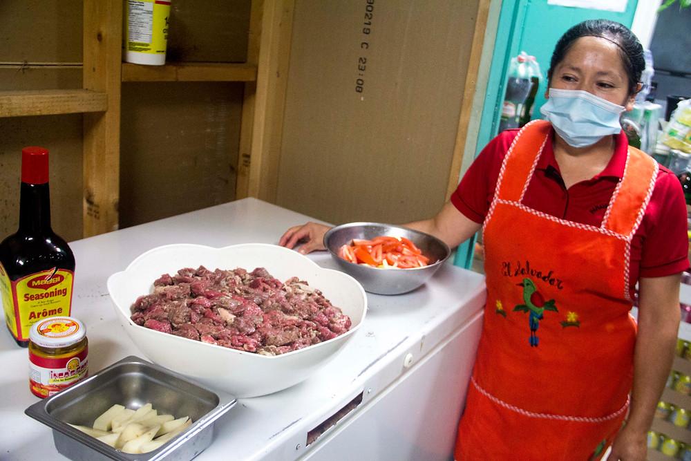 María Flores, a cook at Paraiso Tropical North, prepares Peruvian dish limo saltedo.