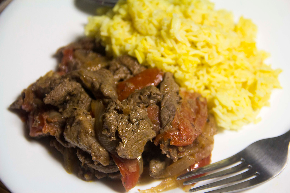 Lomo saltado served with rice.