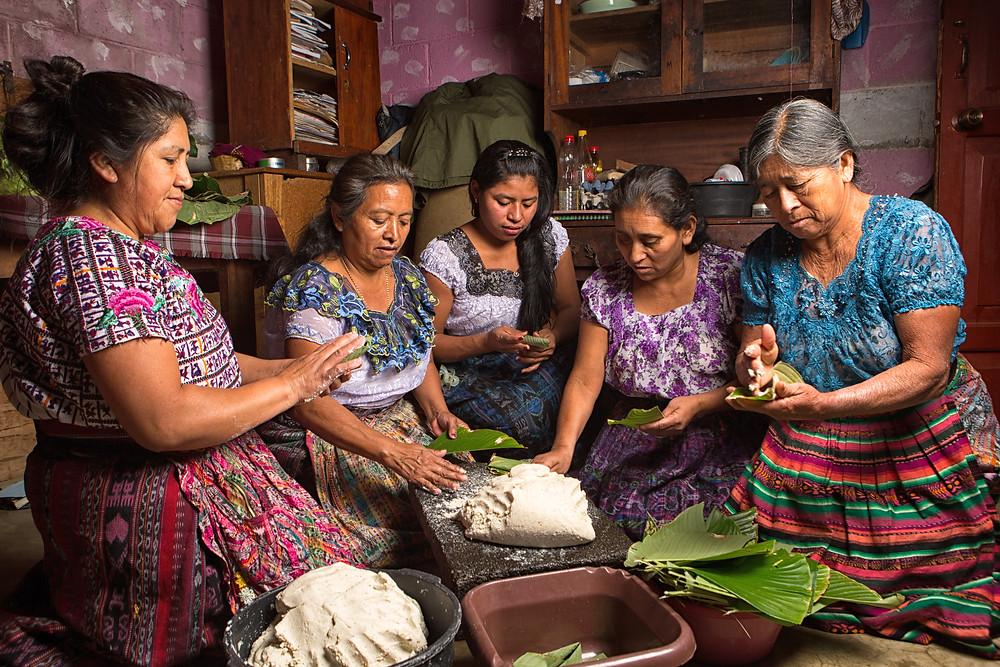 January 20, 2015 San Pedro la Laguna, Guatemala: tzutujil mayan women preparing traditional food together