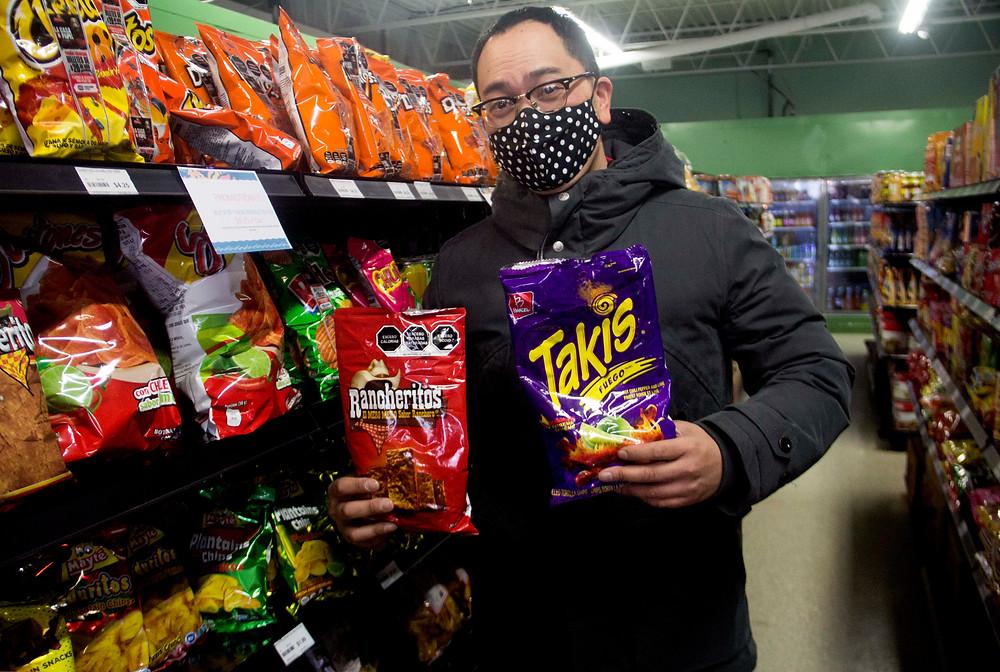 Paraiso Taste Panelist Michael Villaraza with Takis and Rancheritos chips.