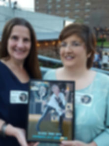Bark Dog Spa & Boutique owners accepting the 2017 Flagpole Favorites Award