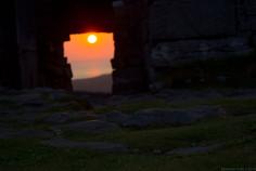 sunset through Dún Aonghusa.jpg