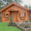 Arklow Log Cabin by Timber Living of  the log cabin built and surrounded by beautiful plants