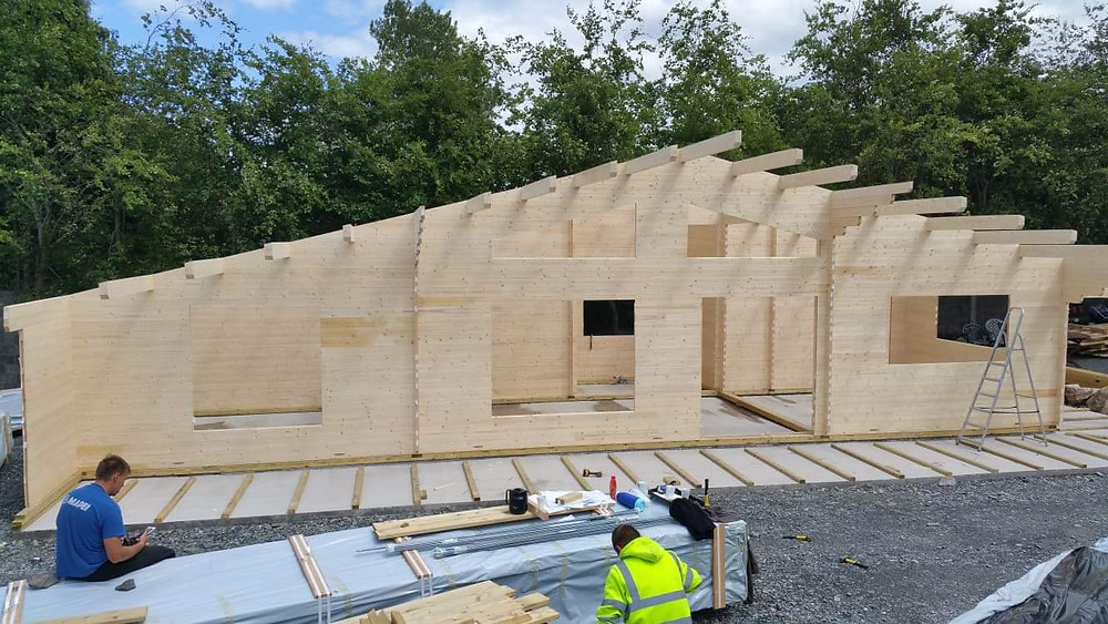 Log cabins walls constructed - awaiting roof
