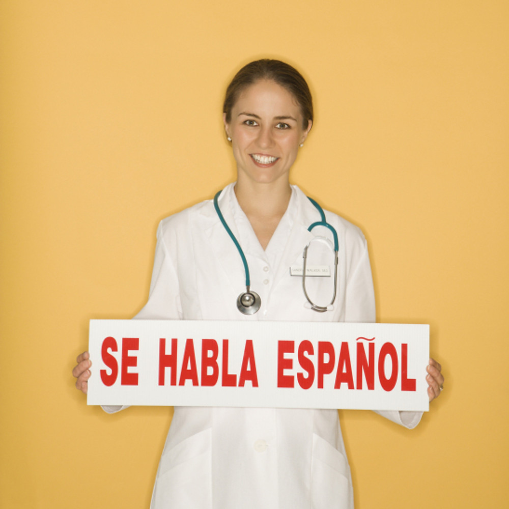 Portrait of Caucasian mid-adult female doctor holding up se habl