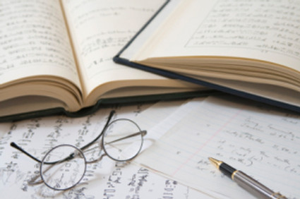 translator glasses and books_ARTICLE_What makes a perfect translation PM