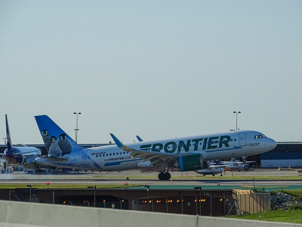 Frontier airlines plane getting ready for takeoff