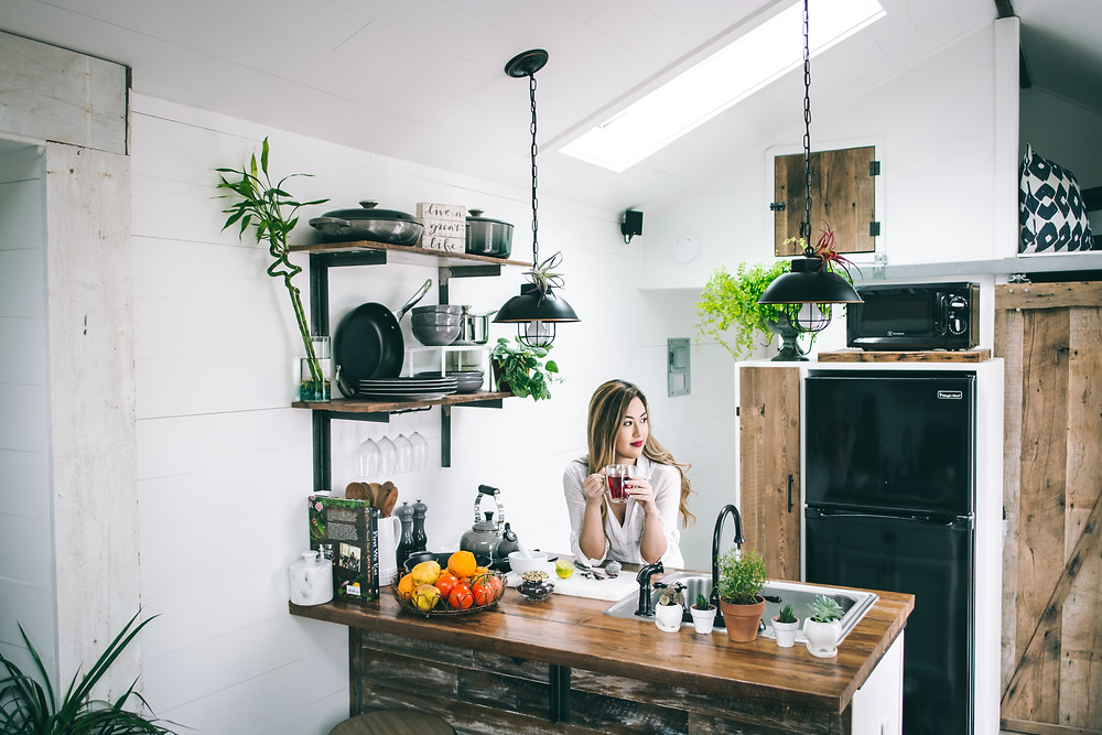 woman drinking coffee in kitchen of home