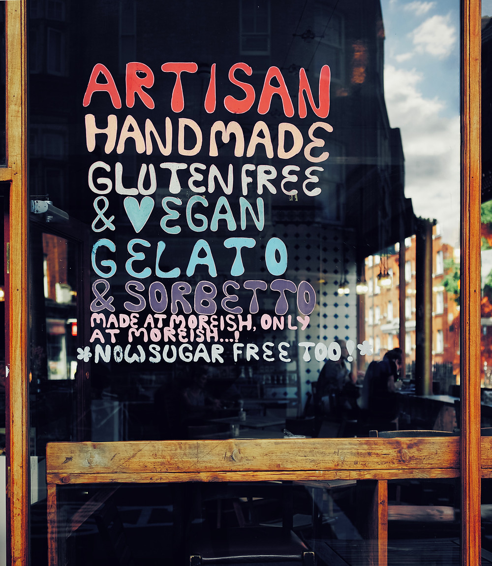 Artisan, handmade, gluten-free, and vegan gelato sign on window