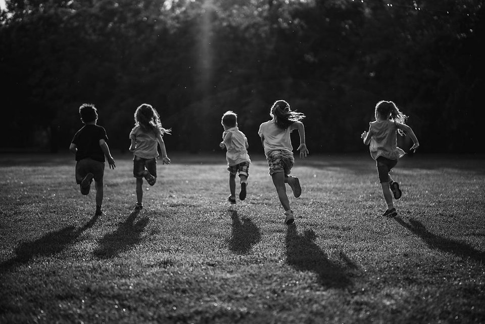 back-view-group-of-children-running-in-n