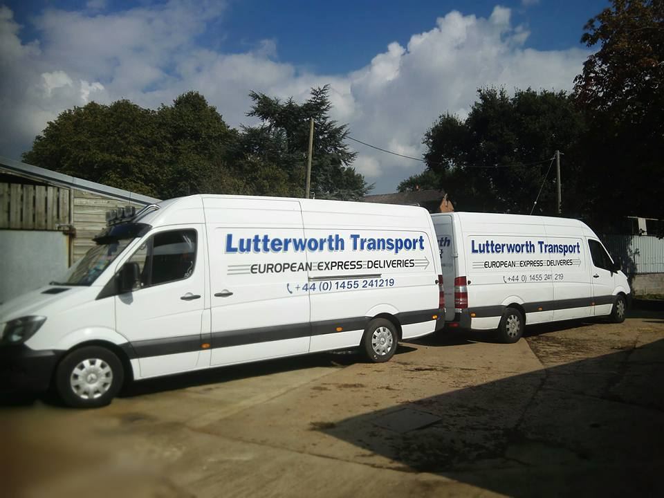 Our vehicles back to back at our depot