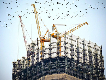Do All Building Infrastructure Contracts Overrun?