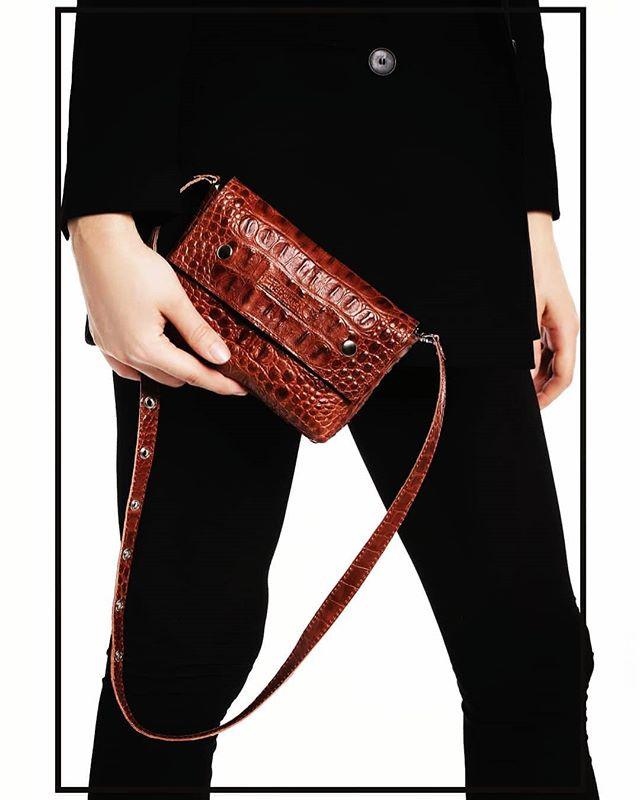 Crocodile effect belt and cross-body bag.