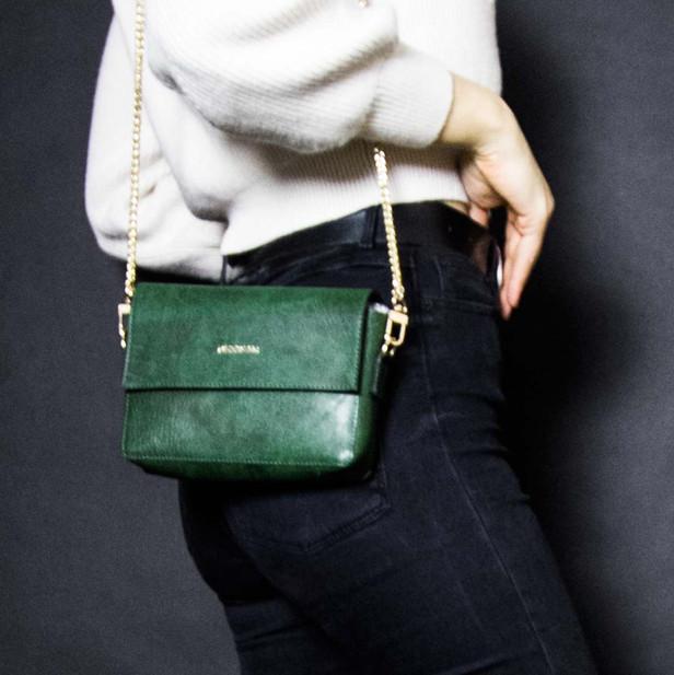 Deep green belt bag.