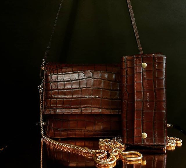 Brown croco effect leather bag and wallet.