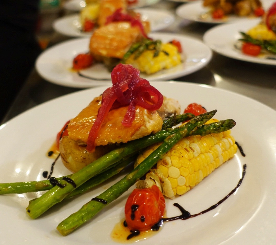 Salmon dinner prepared by chef