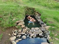 warm bath in Hrunalaug natural geothermal pool, Iceland,Thjorsardalur valley day tour