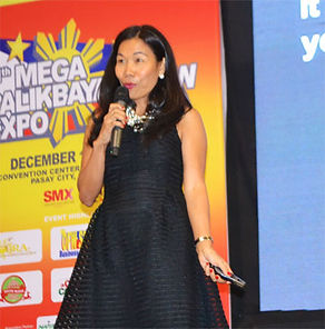 Rebecca providing keynote address to an OFW event at SMX conference center in Manila