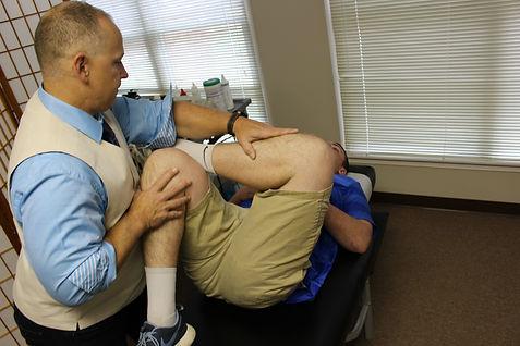 Chiropractor stretching patient