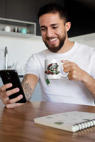 mug-mockup-of-a-tattooed-man-having-some