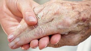 Elderly-senior-citizen-s-hand-held-by-yo