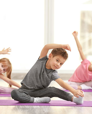 Group of children doing gymnastic exerci