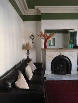 Guest lounge with marble fireplace