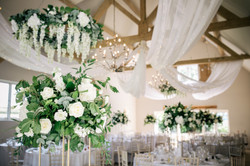 Floral chandeliers draping fairy lig