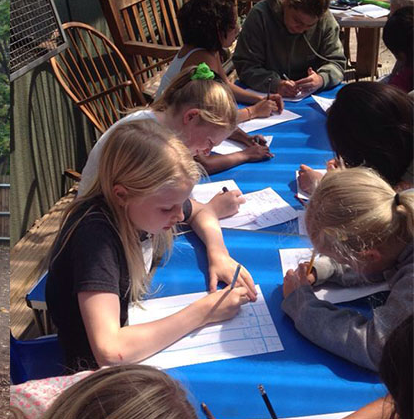 Kids writing at table.png