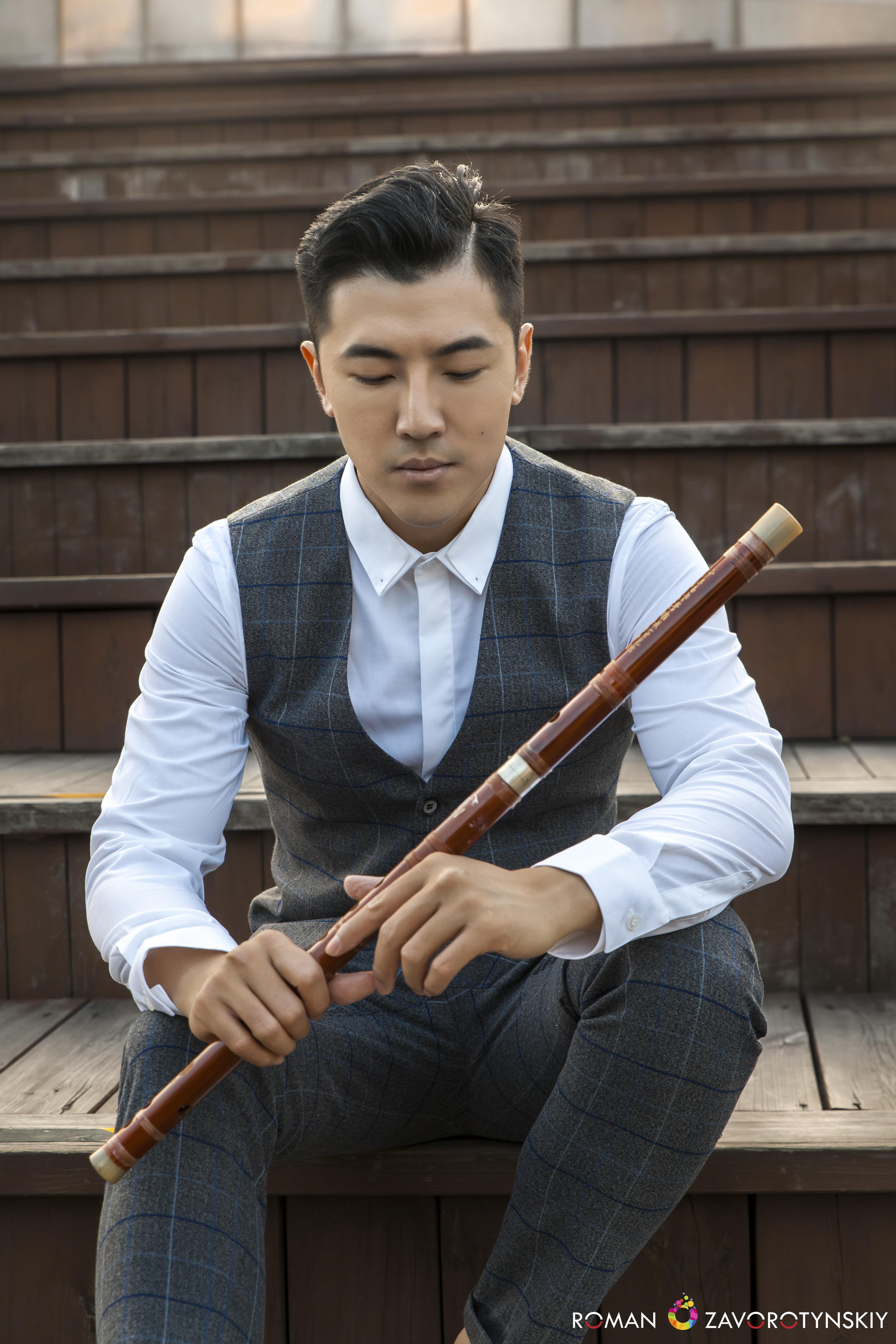 Tao Ye mit Bambusflöte