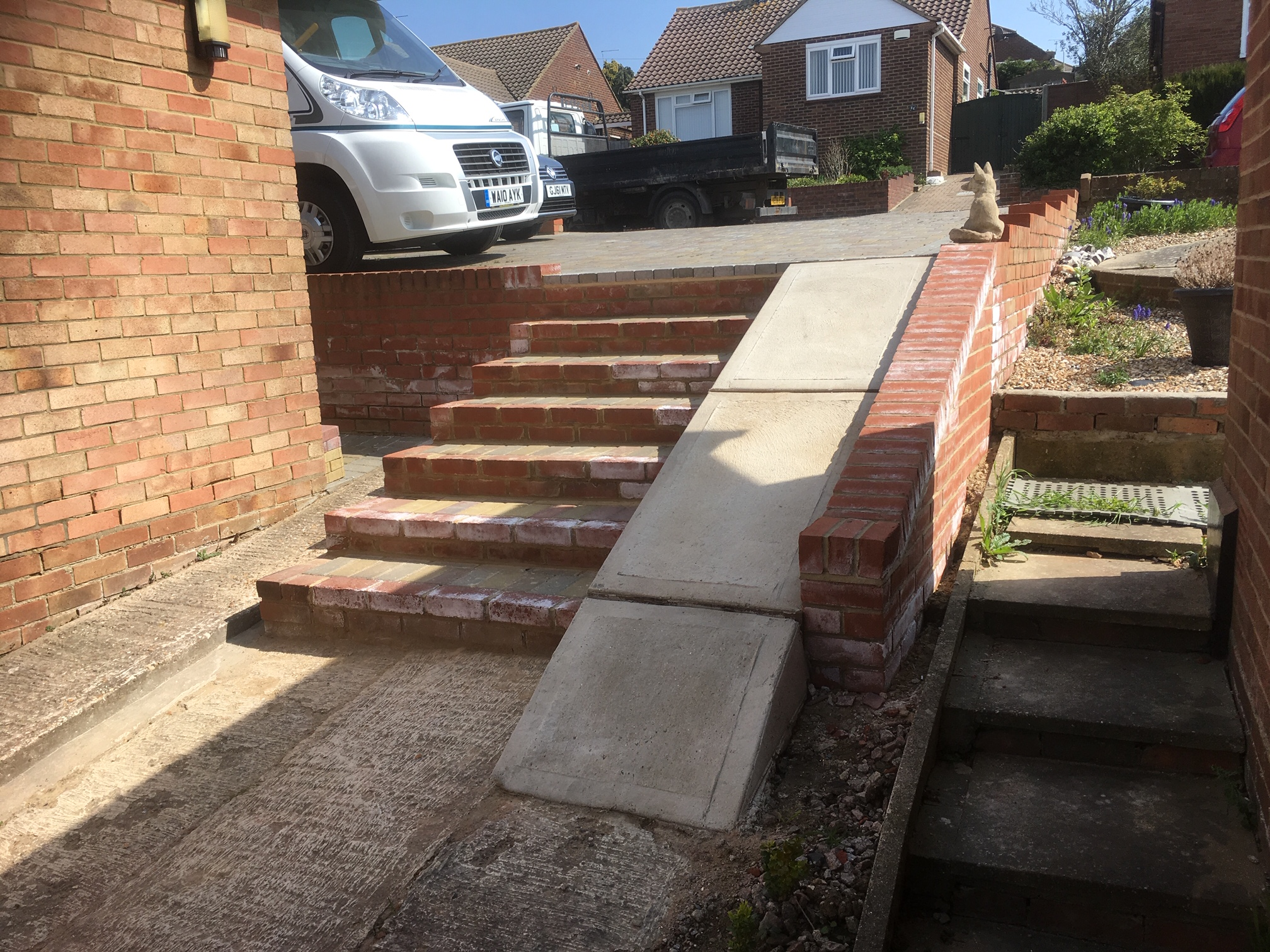Brick Step and Concrete Slope