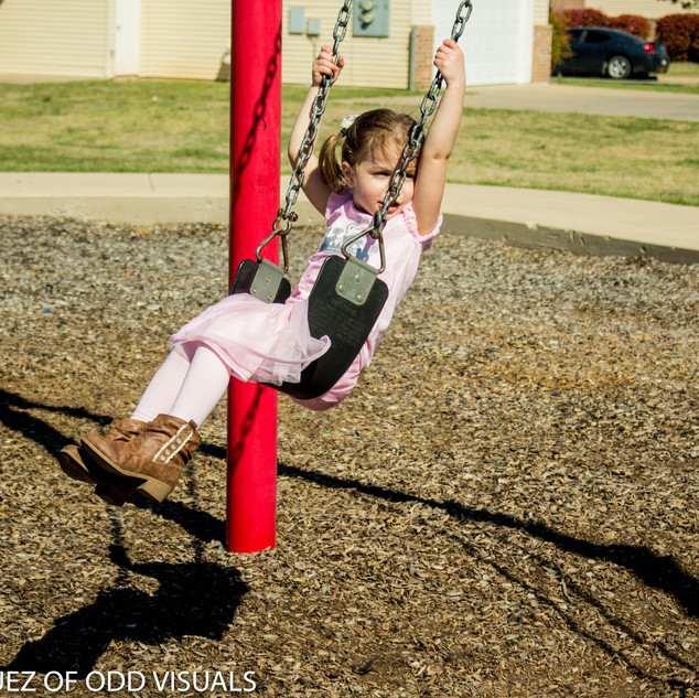 PICTURE OF MY DAUGHTER SWINGING