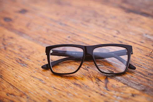 black-frame-wayfarer-eyeglasses-on-brown