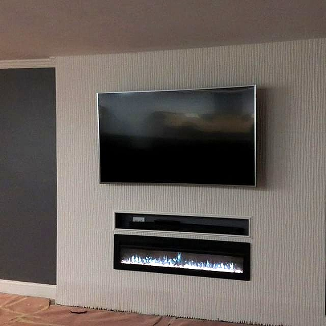 Tile accent wall with electric fireplace