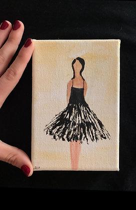 ציור קטן של אישה בשמלה שחורה