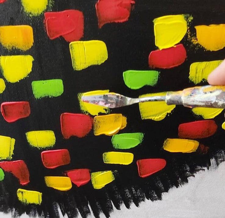 ציור בשפכטל , ירוק צהוב ואדום על רקע שחור