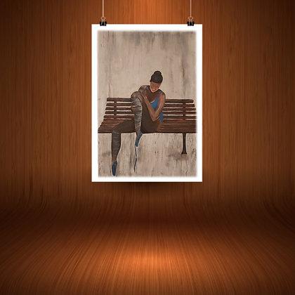 רקדנית באלט על ספסל חום