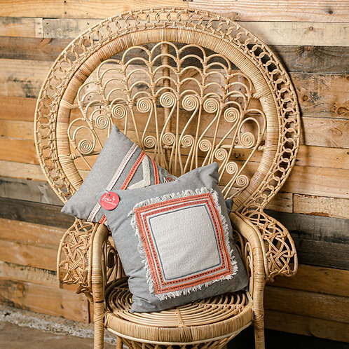 grey and coral patterned cushion