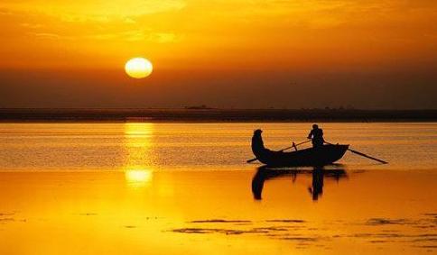Boat under sunset