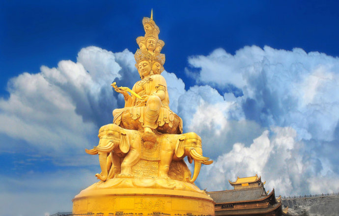 Golden statue on the peak